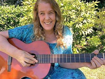 Cynthia Sue Larson with guitar